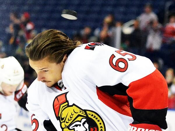 I love guys warmin up w/out lids, but boy, Erik Karlsson had a close one