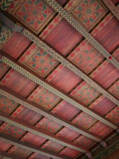 Simple, repeated patterns on beams or on the flat of the ceiling. Squared panels.