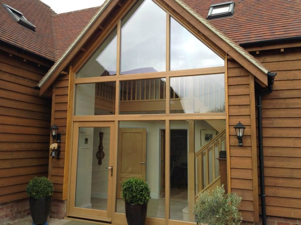 Gable End Featuring Fixed Glass Windows And Entrance Door All In A Light Oak Front Porch Design Contemporary Front Doors House Front Porch