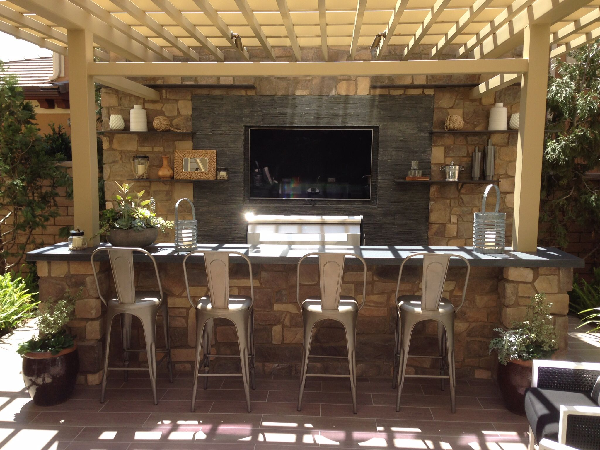 tv wall and outdoor kitchen outdoor