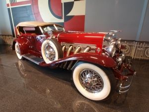 """A Duesenberg Dual-Cowl Phaeton.  External exhaust pipes mean this would likely have been a super-charged J car (a so-called """"SJ"""")."""