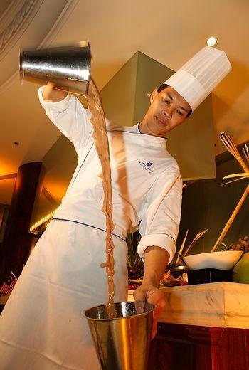 Teh Tarik (pulled milk tea).  Can be pulled milk coffee, hot chocolate...must be hot drink!