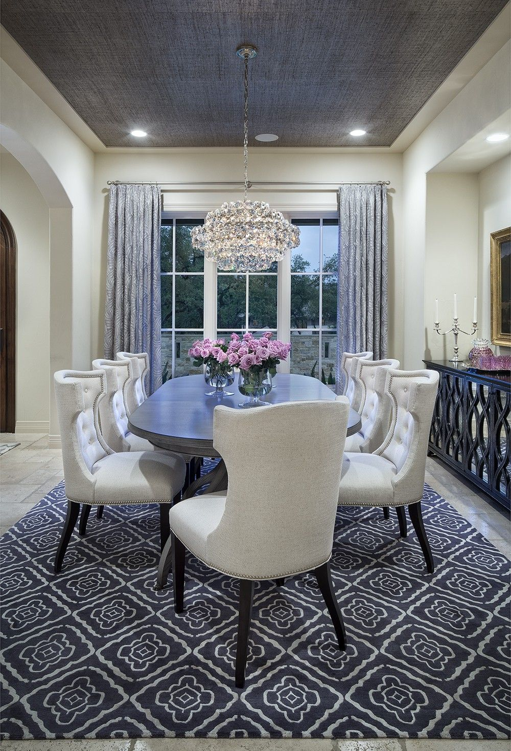 Cream colored dining room with grey rug curtains and for Dining room rug ideas