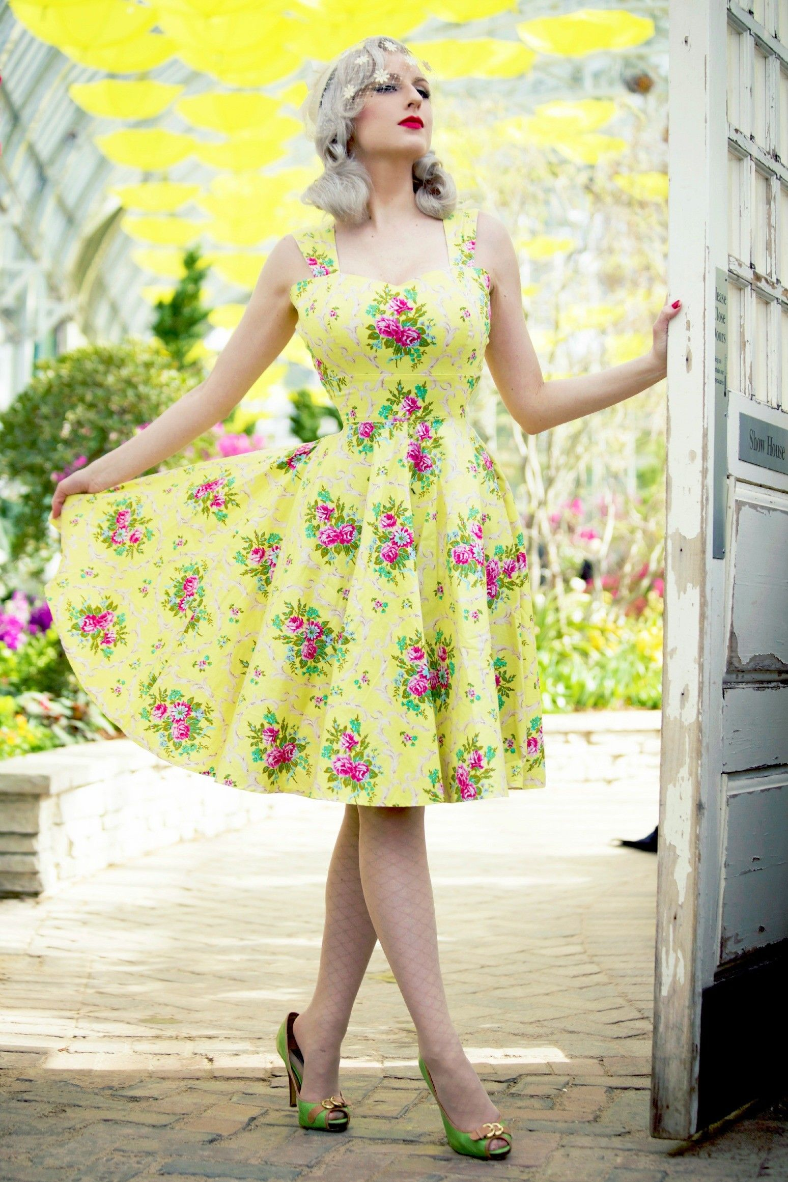 yellow floral 50s dress vintage style pigtails and