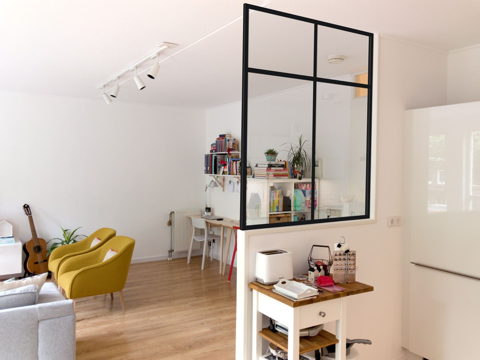 Black metal framed window kitchen divider arquitecture