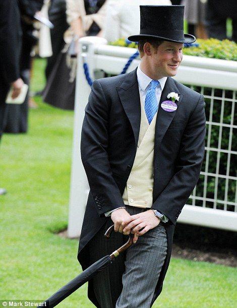 Prince Harry twirls his umbrella as he walks through the Royal Enclosure 19 June 2014