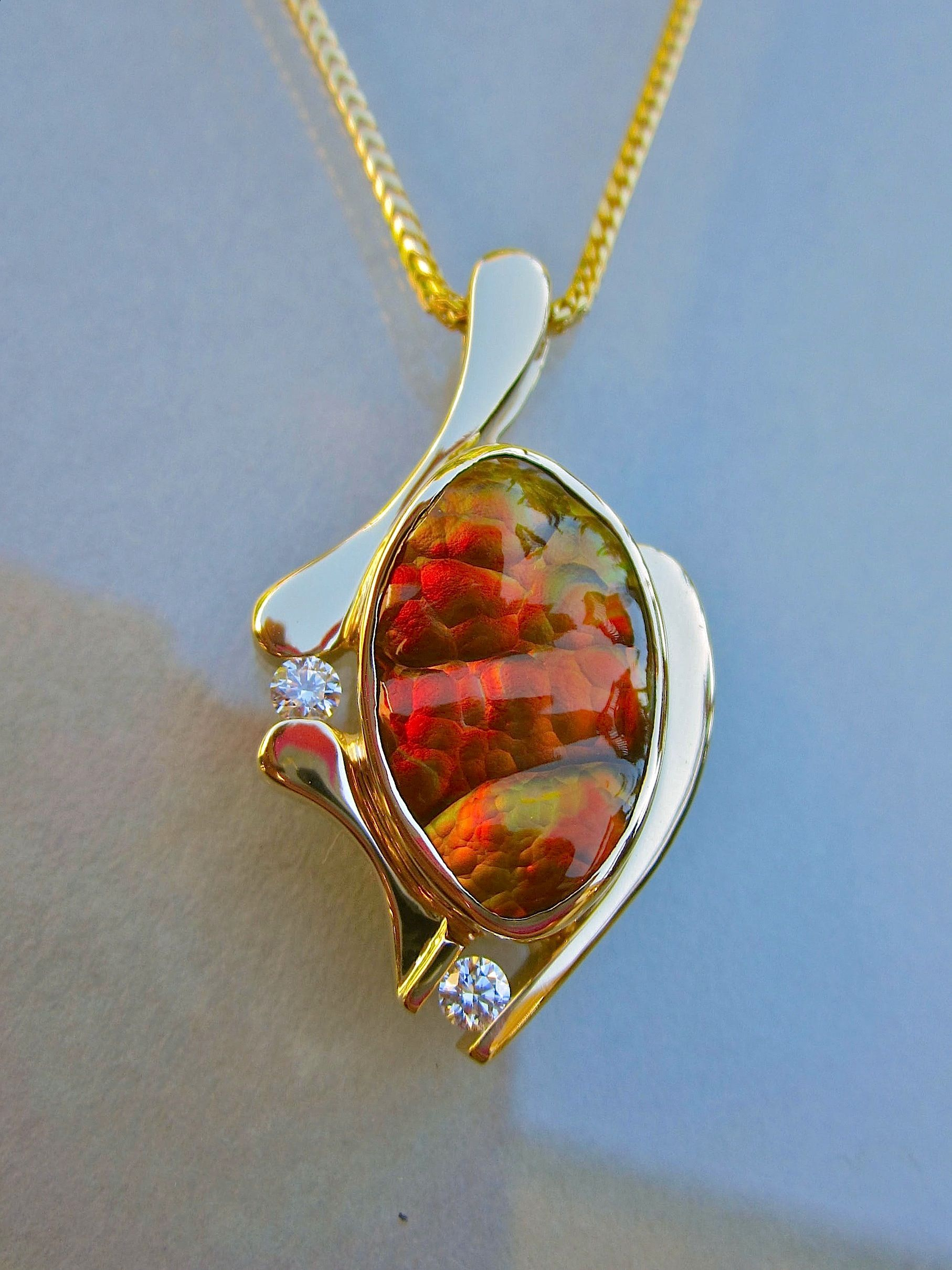 One of a kind fire agate and diamond pendant by Glenn Dizon Designs. Available.