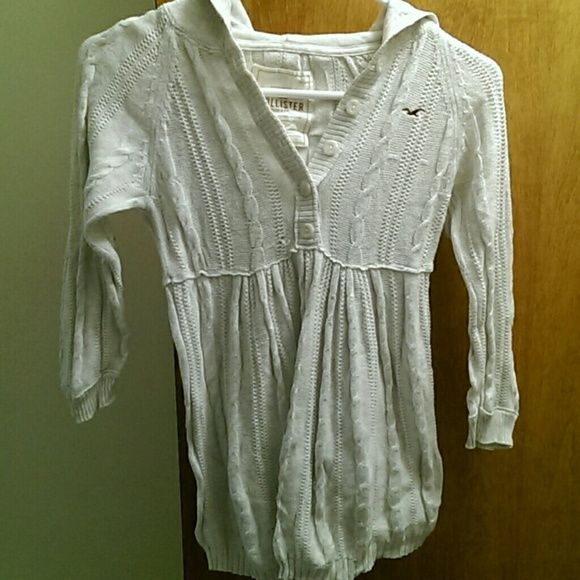 Hollister hooded sweater Baby doll sweater. Medium fits more like small 4 button closure on chest.defect: pulled string on front. Check pic for accuracy :) Hollister Sweaters