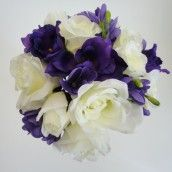 Purple has been popular for several months.  We think it looks great with silver for a Christmas Wedding or hot pink for a summer wedding. Take a look at our Purple Freesia & Ivory Rose Silk Wedding Bouquet