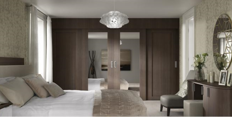 Dark wood large format sliding wardrobe doors here the Vigo