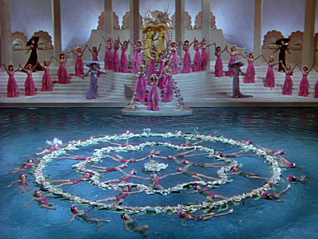 An Esther Williams synchronized water ballet movie, director Busby ...