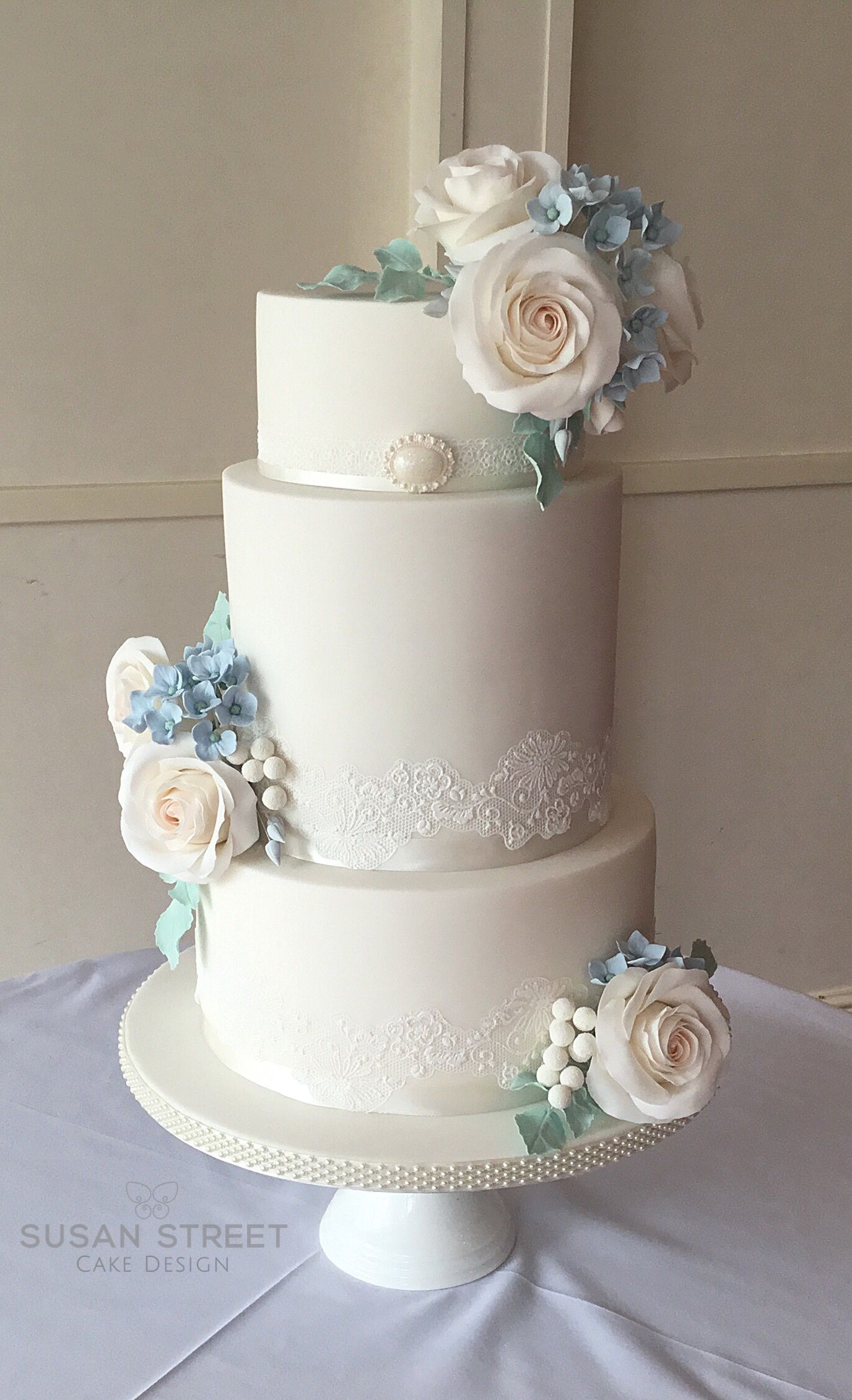 Three Tier Ivory Wedding Cake With Handmade Sugar Roses And Pale