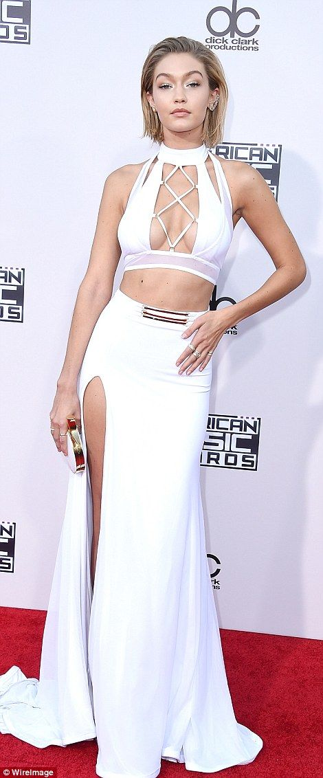 Wow factor! Gigi Hadid went for maximum glam in a tummy and cleavage baring white two-piece