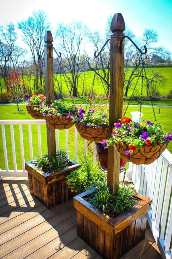 Hanging planters decoraci n jardines patios terrazas for Decoracion de jardines con macetas