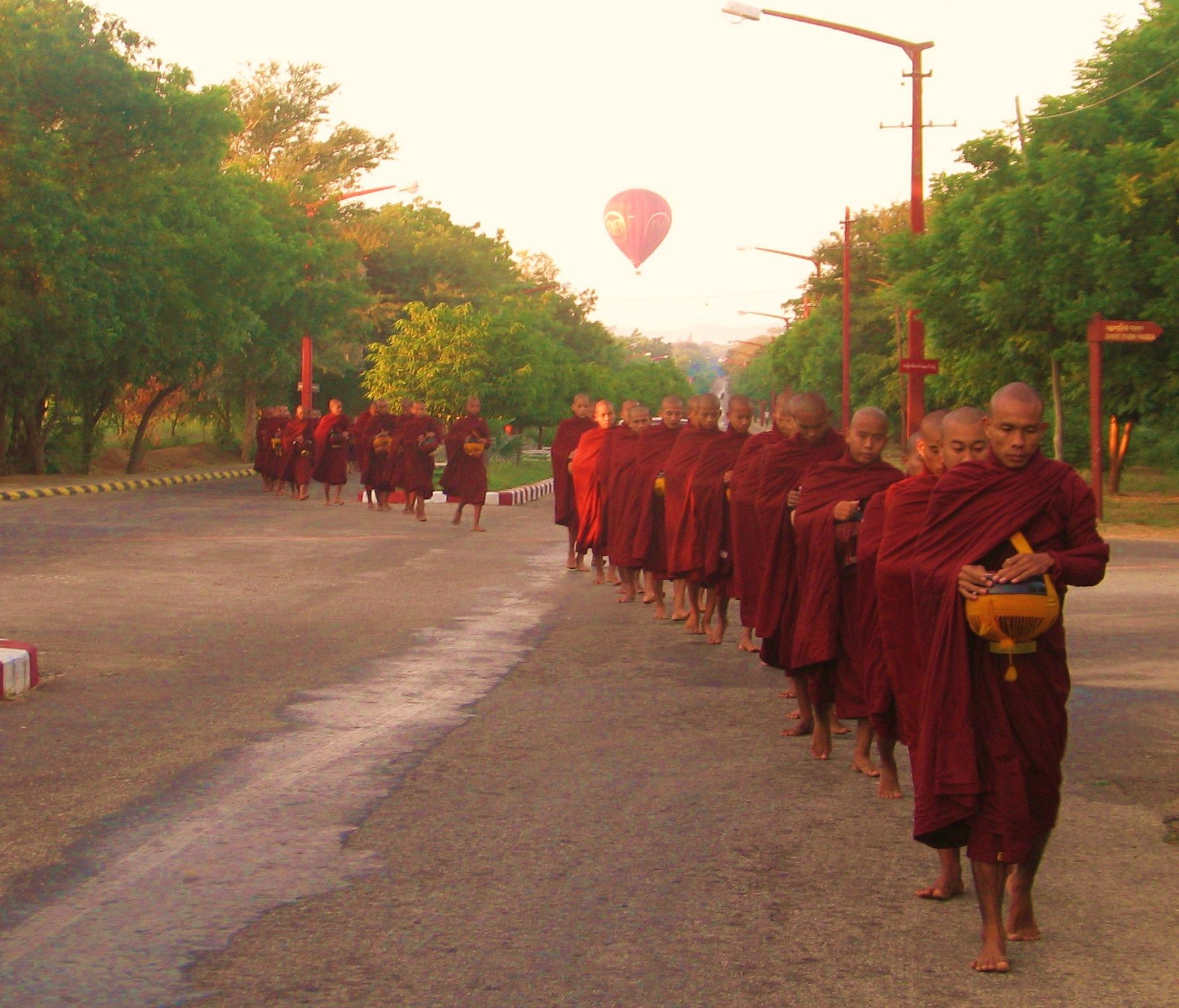 Monks in procession and an air balloon