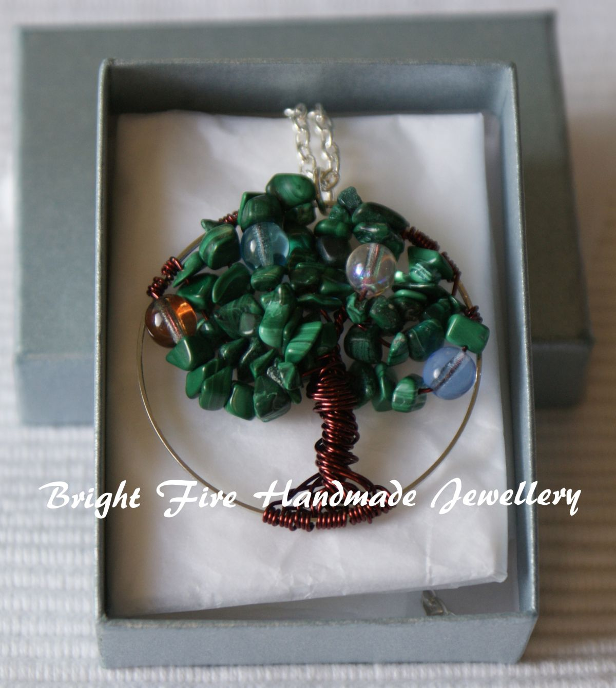 Family Tree Neckace, by Bright Fire Handmade Jewellery.  A hand wrapped wire work tree with Malachite leaves and glass bead birthstones.