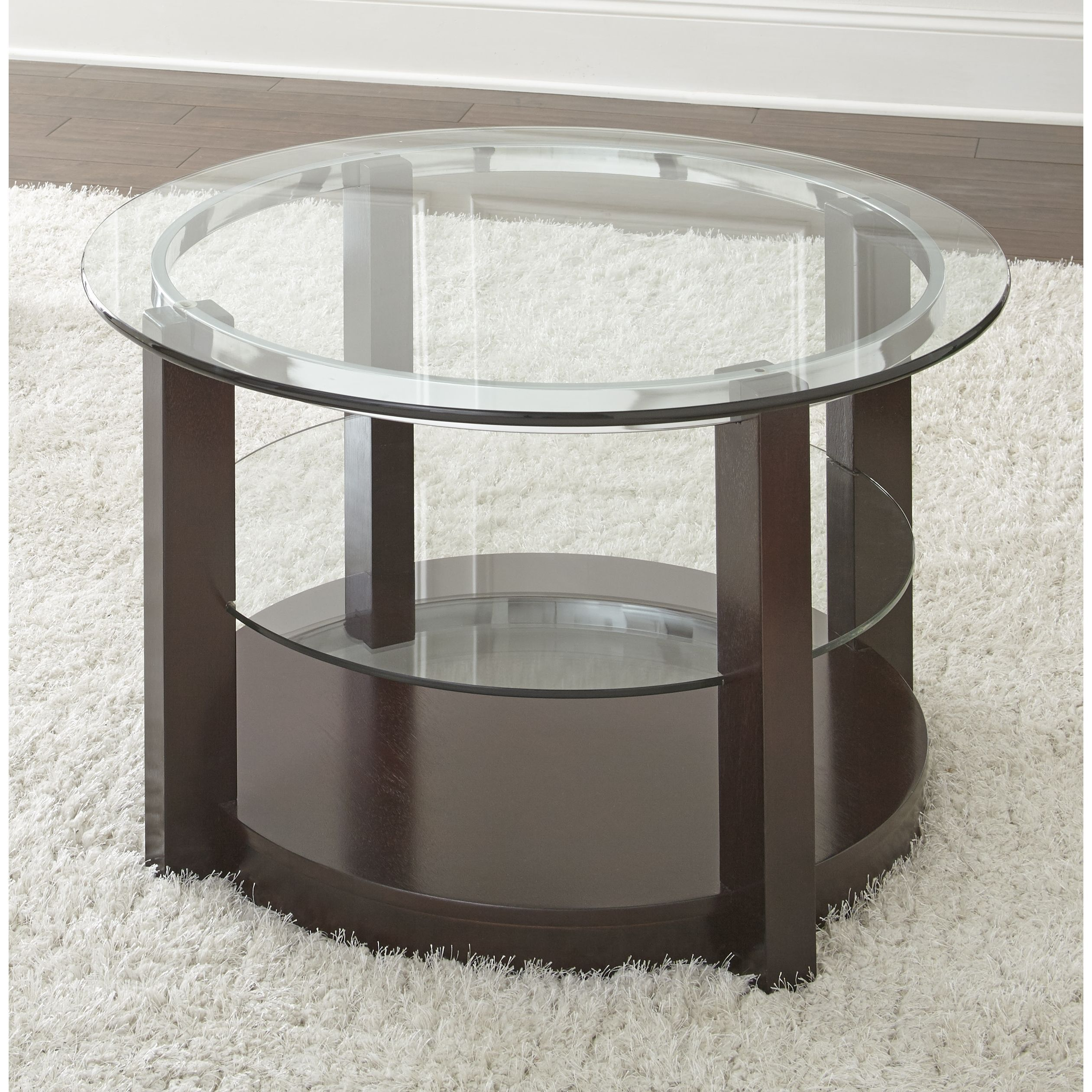 The sleek espresso finish and tempered glass top of the Crawley coffee table  will complement many styles. Accented by a decorative chrome ring, and tempered glass shelf, this table also features hidden casters for easy movement.