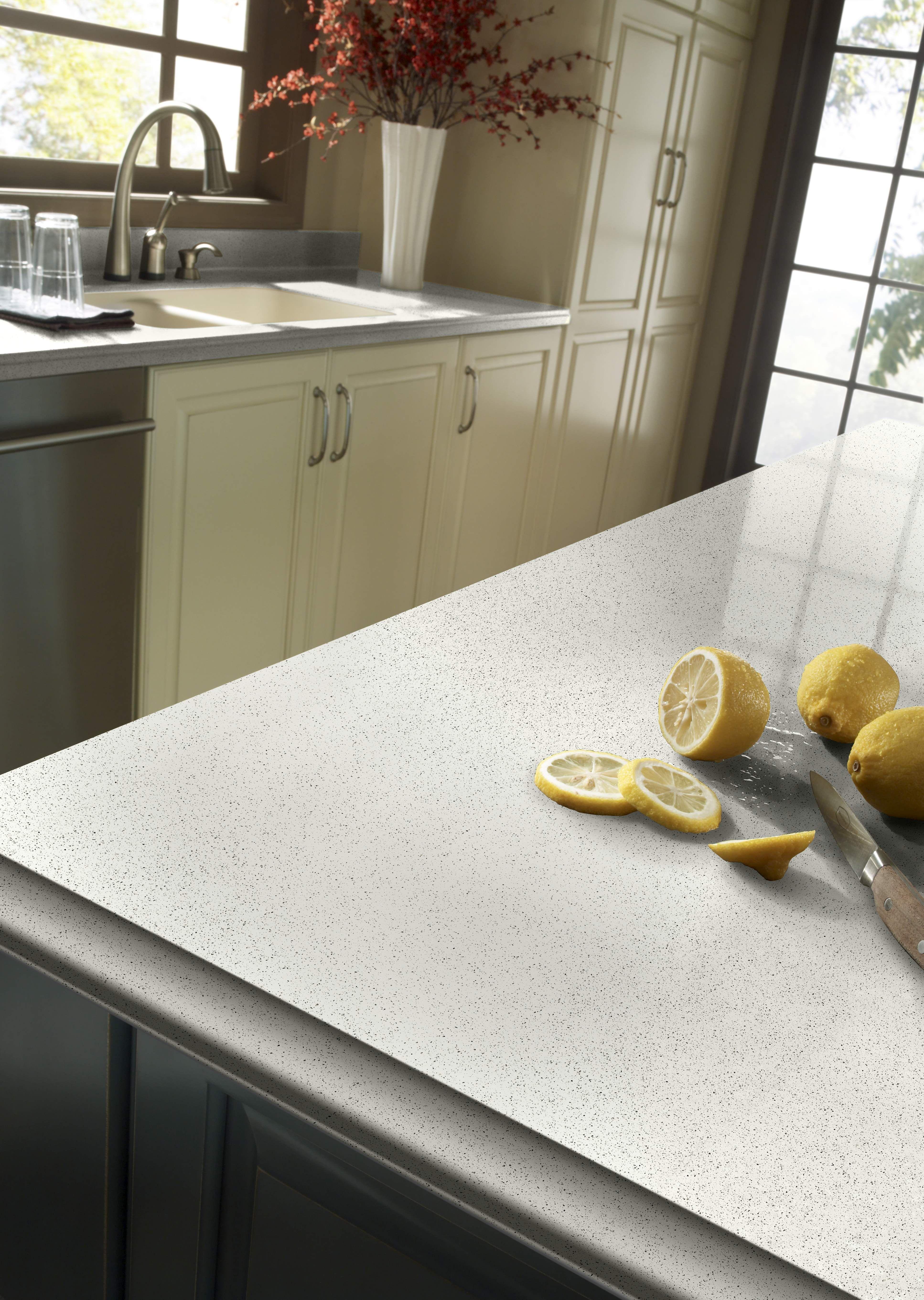 Modern kitchen with snow white quartz counter long peninsula and white - Zodiaq Snow Flurry Quartz Countertopsbathroom