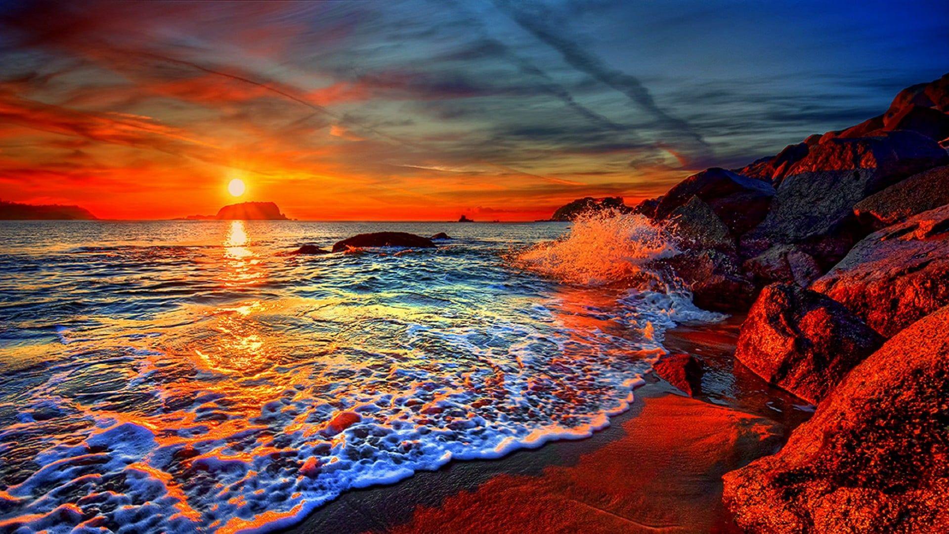 Sky Water Beach Sea Ocean Sand Rock Sunset Sunrise Cloudscape Storm Blue Orange Android Wallpapers Beach Sunset Images Sunset Pictures Sunset Beach Pictures