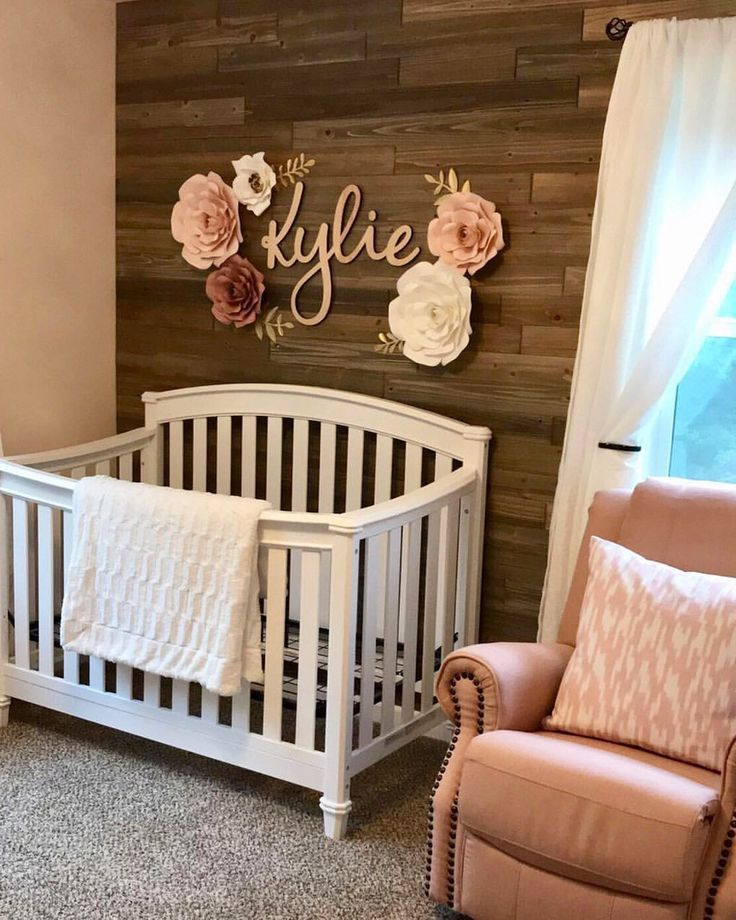 Photo of Paper flower field name over crib. Nursery decor. Wooden accent wall. Kin …