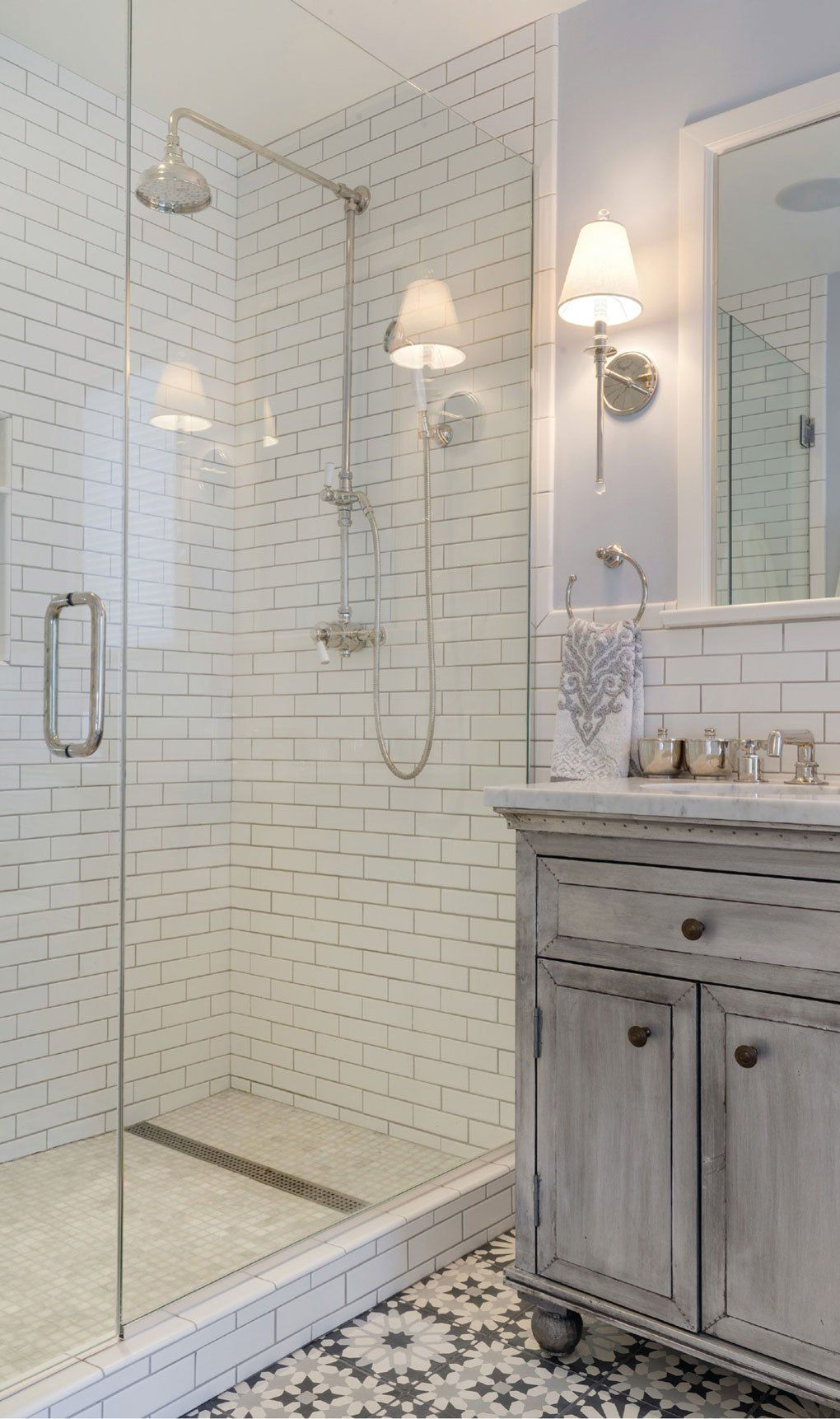 The master bathroom features subway tile carrara marble and the master bathroom features subway tile carrara marble and moroccan style cement tile dailygadgetfo Choice Image