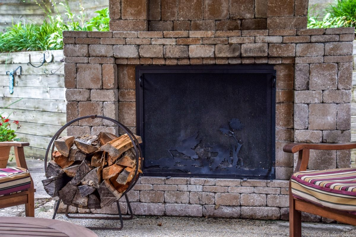 A closeup of the stone fireplace that was part of the backyard