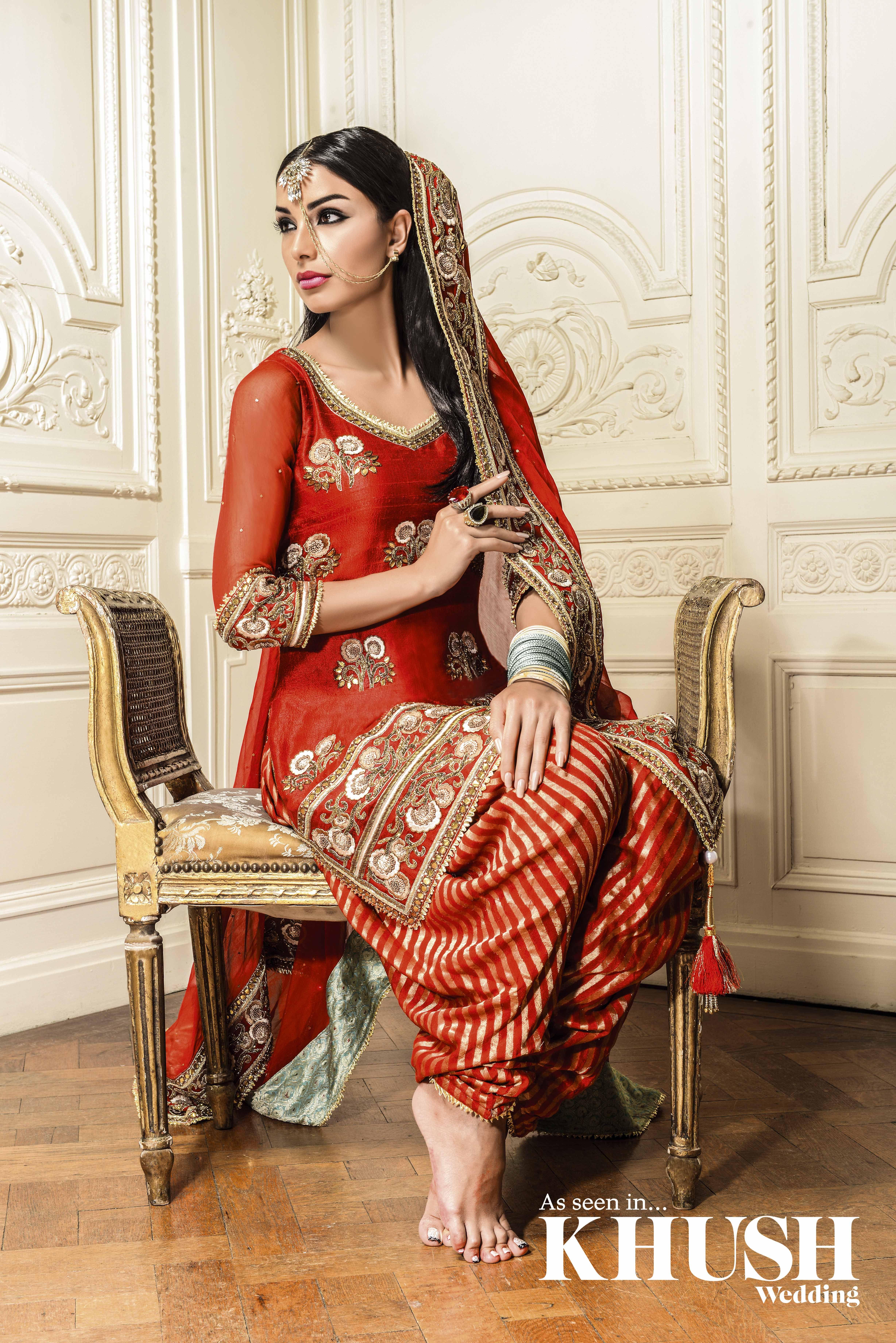 Deep red art silk embroidered salwar kameez by Vikas Rattu