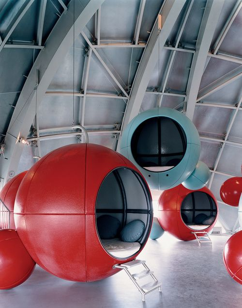 sphere pods inside a large buildings at different levels. wooo! so fun