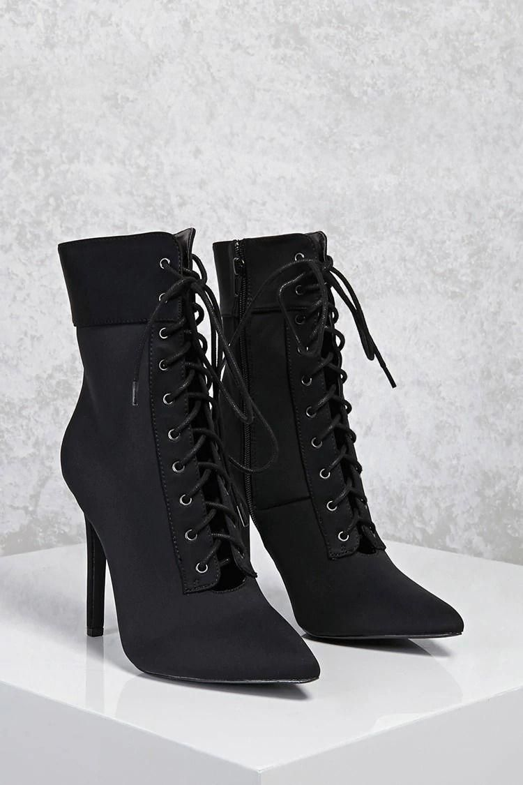 6a1c4e5741b3 A pair of lycra pointed toe ankle boots featuring a lace-up front ...