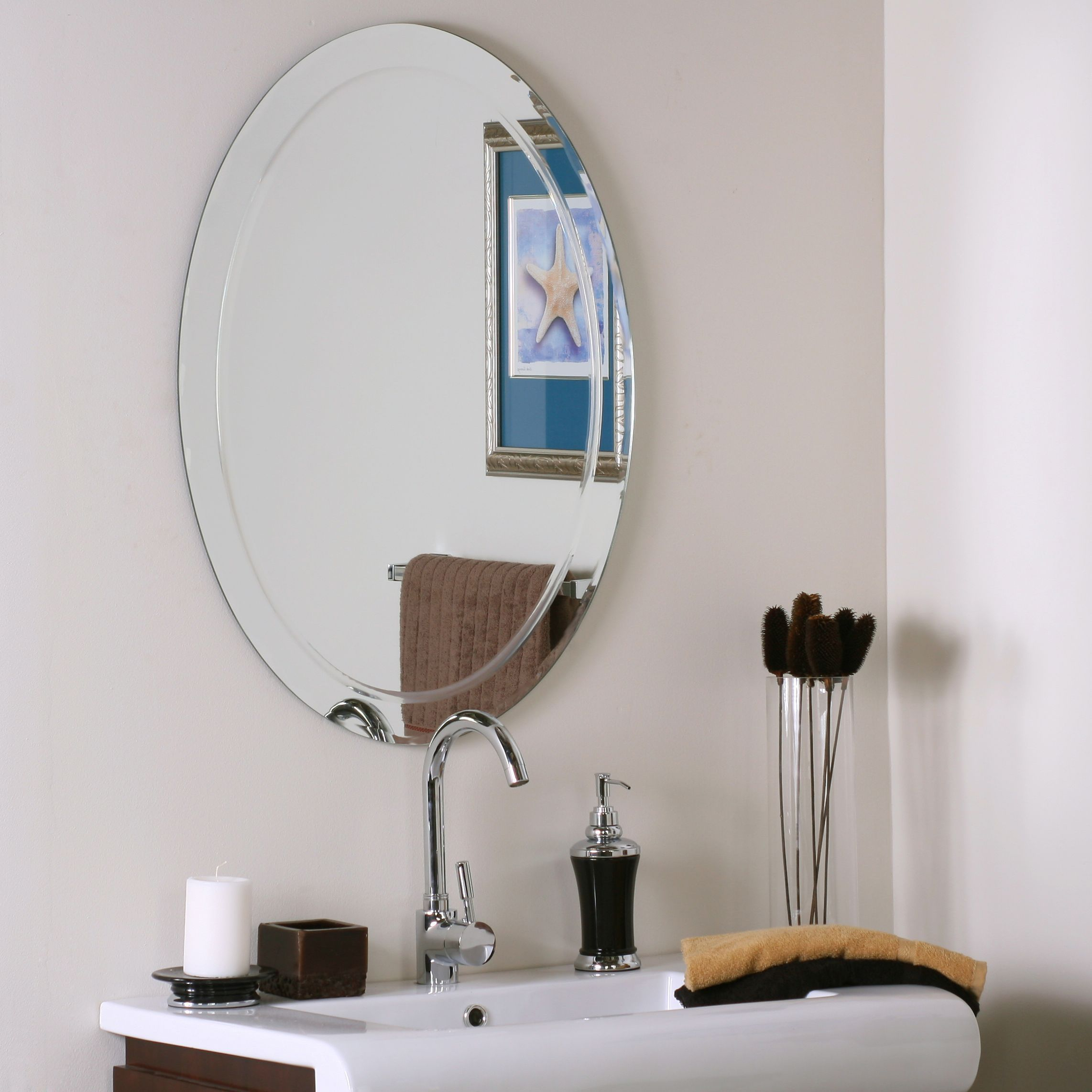 Add a touch of style to your bathroom with this Alden frameless oval ...
