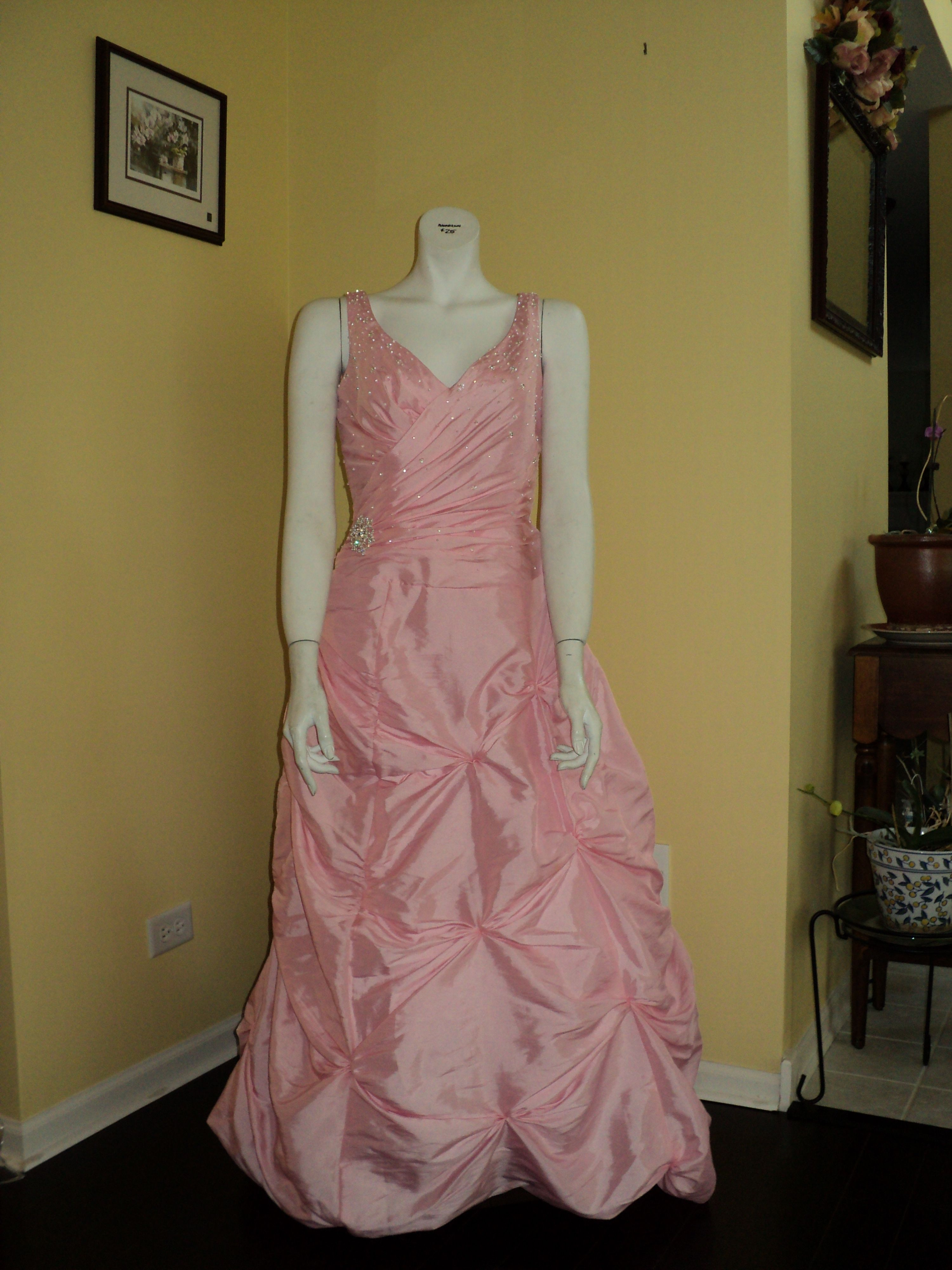 Feel like a princess in this pink taffeta gown. The beading, details, and pickups will give you extra sparkle.