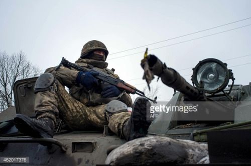 01-21 A Ukrainian serviceman rides on APC at the frontline in... #orlovka: 01-21 A Ukrainian serviceman rides on APC at the… #orlovka