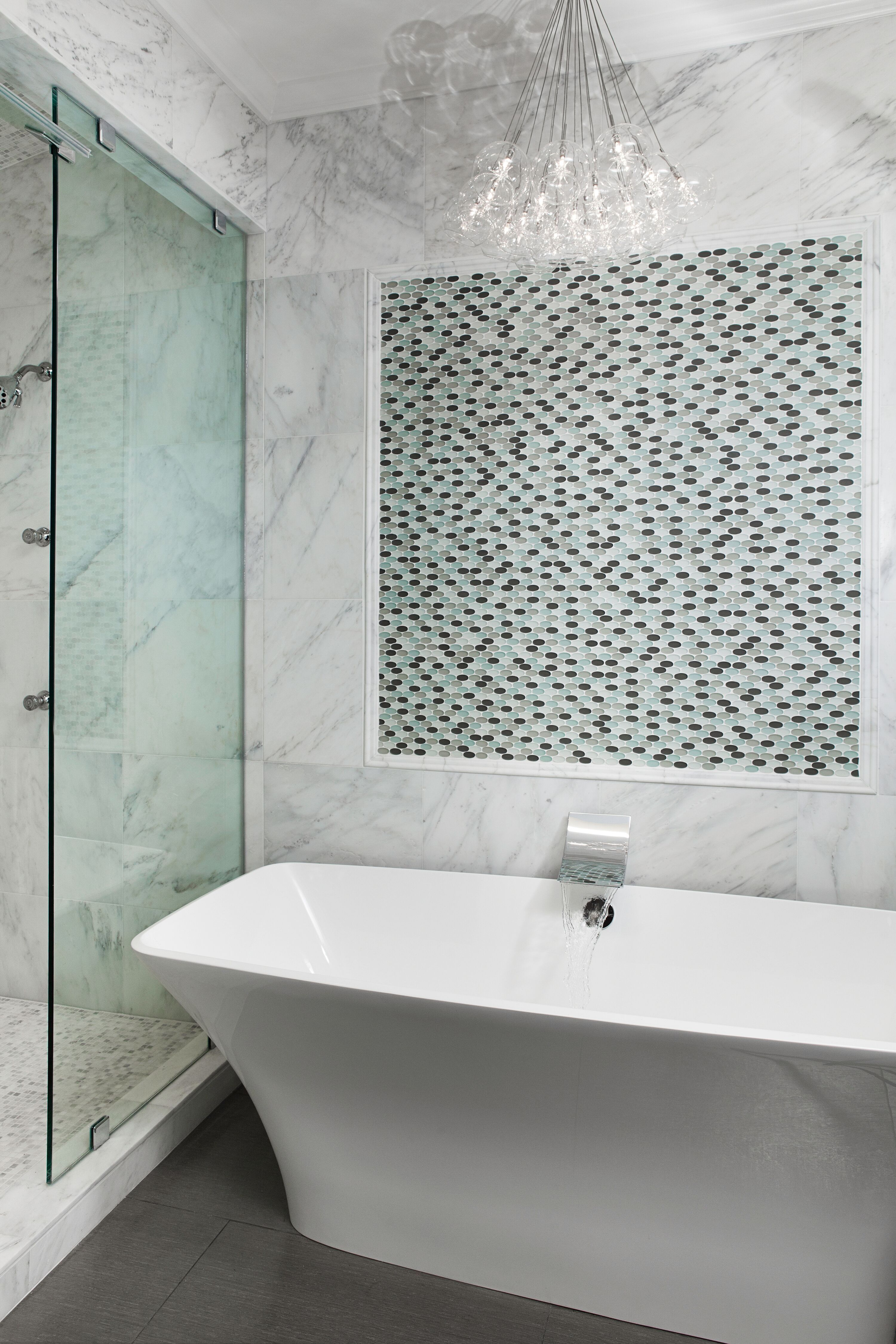 Elegant Bathroom With Freestanding Tub Glass Door And Mosaic Tile