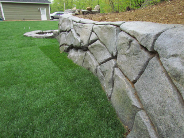 I Think This Is So Cool How It Looks Like Rock But It Is Concrete Retaining Wall Concrete Retaining Walls Rock Retaining Wall