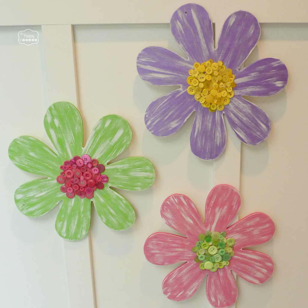Painted Wood Flowers with Button Centers perfect for little big girls room wall décor with full tutorial at thehappyhousie