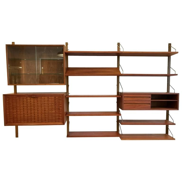 Poul Cadovius for Cado Teak Wall Unit, Denmark, 1960s | From a unique collection of antique and modern cabinets at https://www.1stdibs.com/furniture/storage-case-pieces/cabinets/
