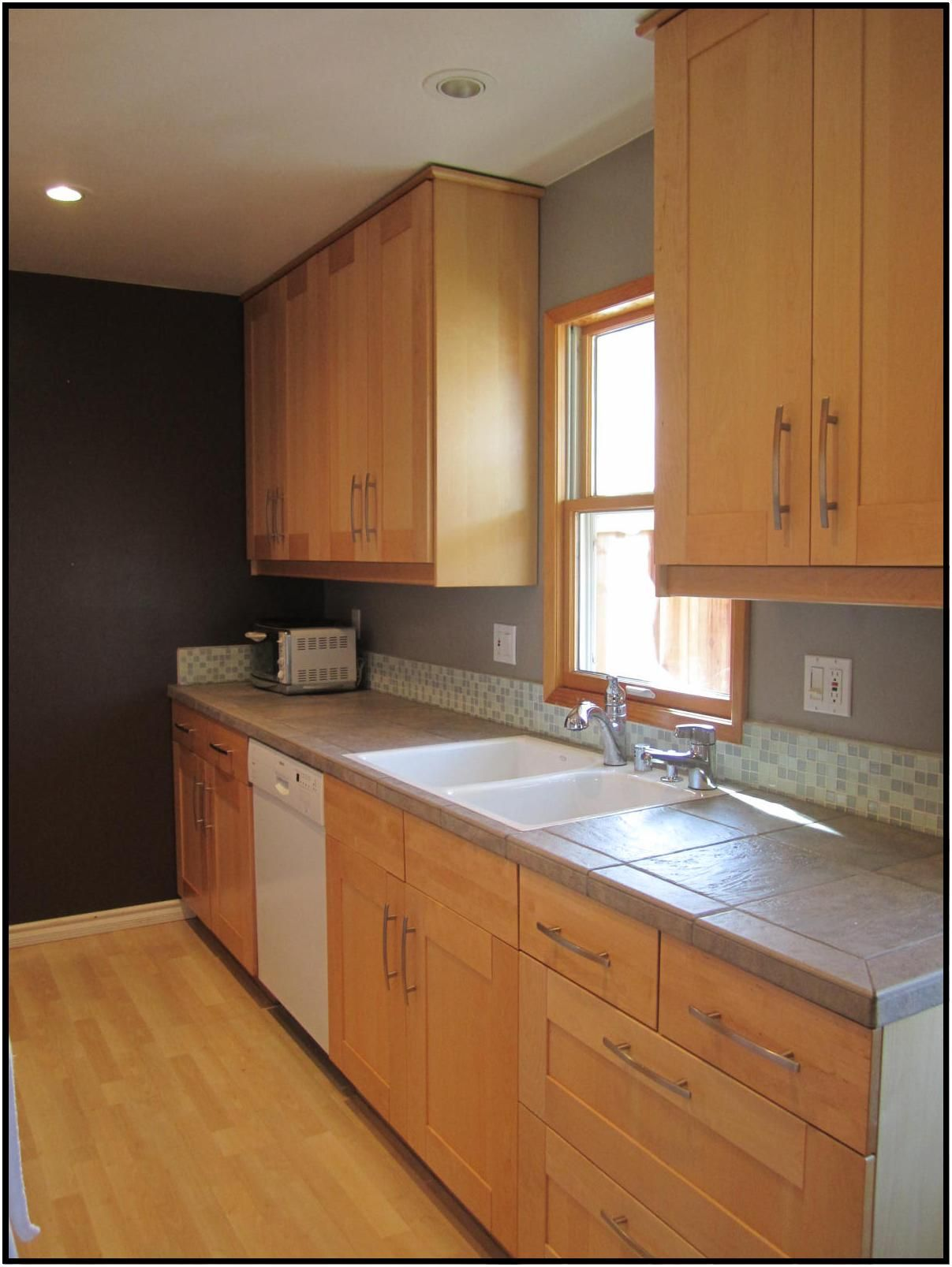 Maple Cabinets Gray Counters And Short Glass Backsplash Backsplash Designs Cheap Backsplash Tile Kitchen Remodel