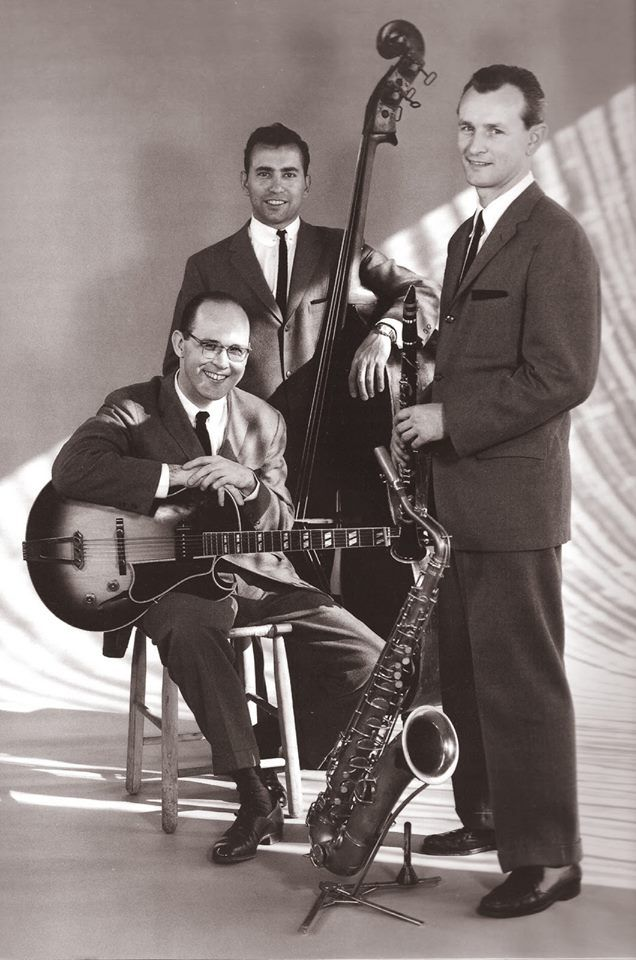 Jimmy Giuffre Trio in 1957 included bassist Ralph Pena and guitarist Jim Hall.