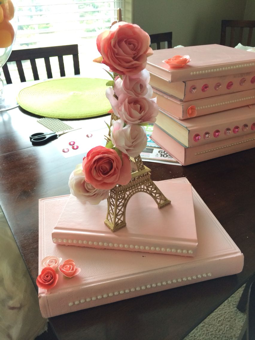 IG: jackiebellexo Making Paris themed centerpieces by hand! Spray painted  old books from a - IG: Jackiebellexo Making Paris Themed Centerpieces By Hand! Spray