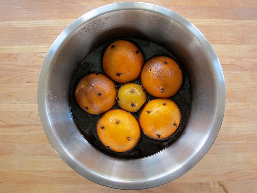 Oranges in a bowl of wine.   Mulled wine, Christmas baking, Alcoholic desserts