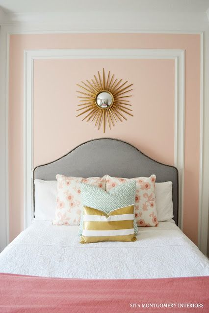 the headboard makes for a nice contrast against the pale peachpink wall
