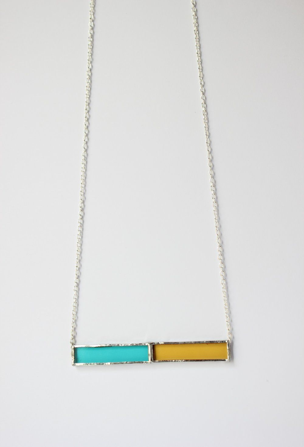Teal & Yellow glass with nickle-free, sterling silver chain in a lead-free…