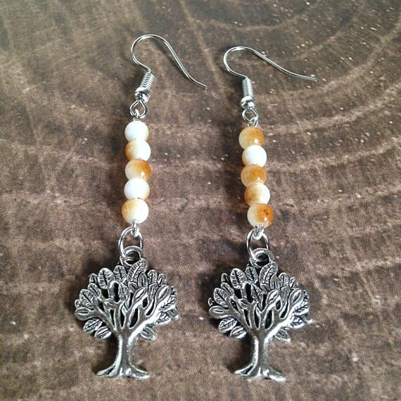 Tree Dangle Earrings with Light Brown Beads  Tibetan Silver Shop: Facebook.com/bohemianheartery  Bohemian Heartery is an online retail shop with a variety of handcrafted and handpicked items. Also, check out Bohemian Heartery's Etsy Shop: Etsy.com/shop/bohemianheartery