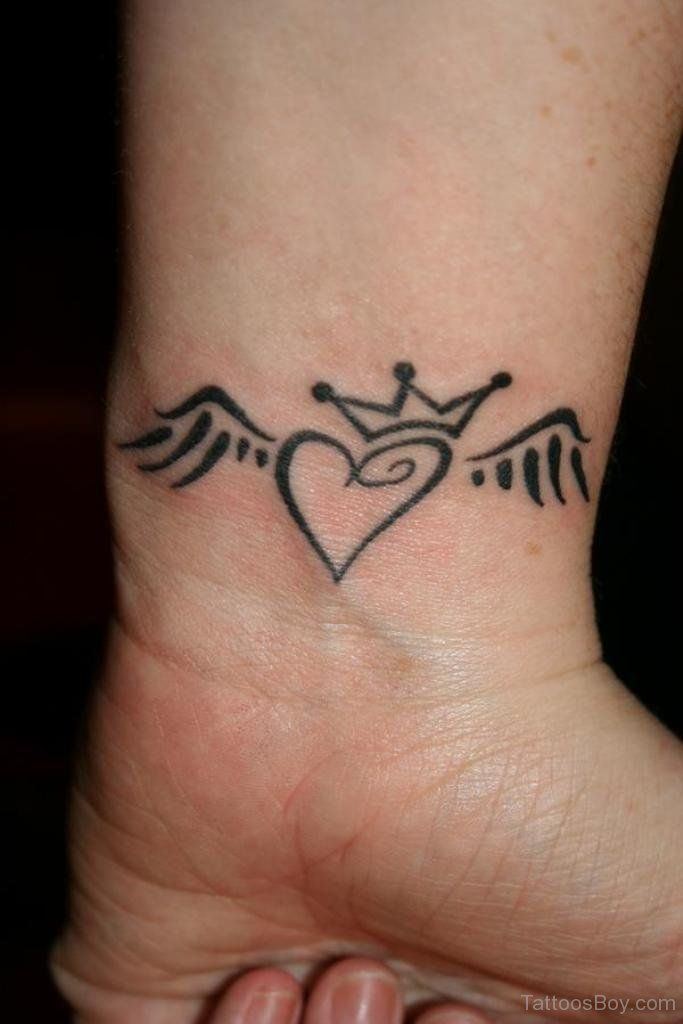 Winged Heart With Crown Tattoo On Wrist Crown Tattoo With Heart