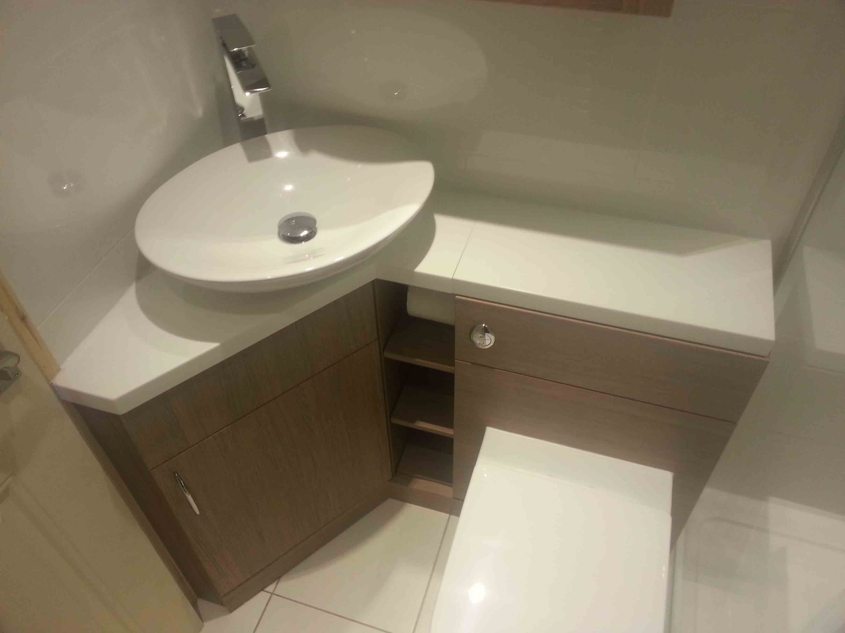 brown corner bathroom vanity with spacious wooden drawers and