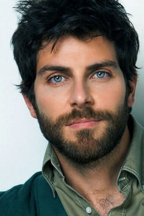 Image result for young man, dark curls, scruffy beard, blue eyes