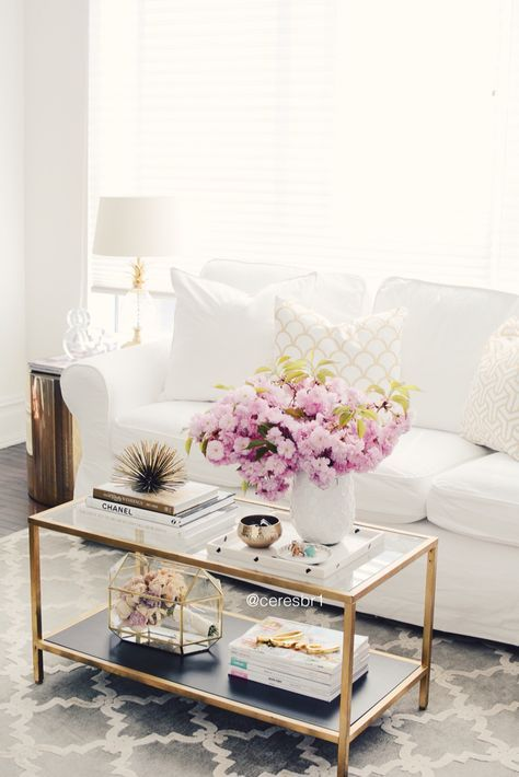 Chic White Sofa Living Room With Gold Coffee Table And Accents