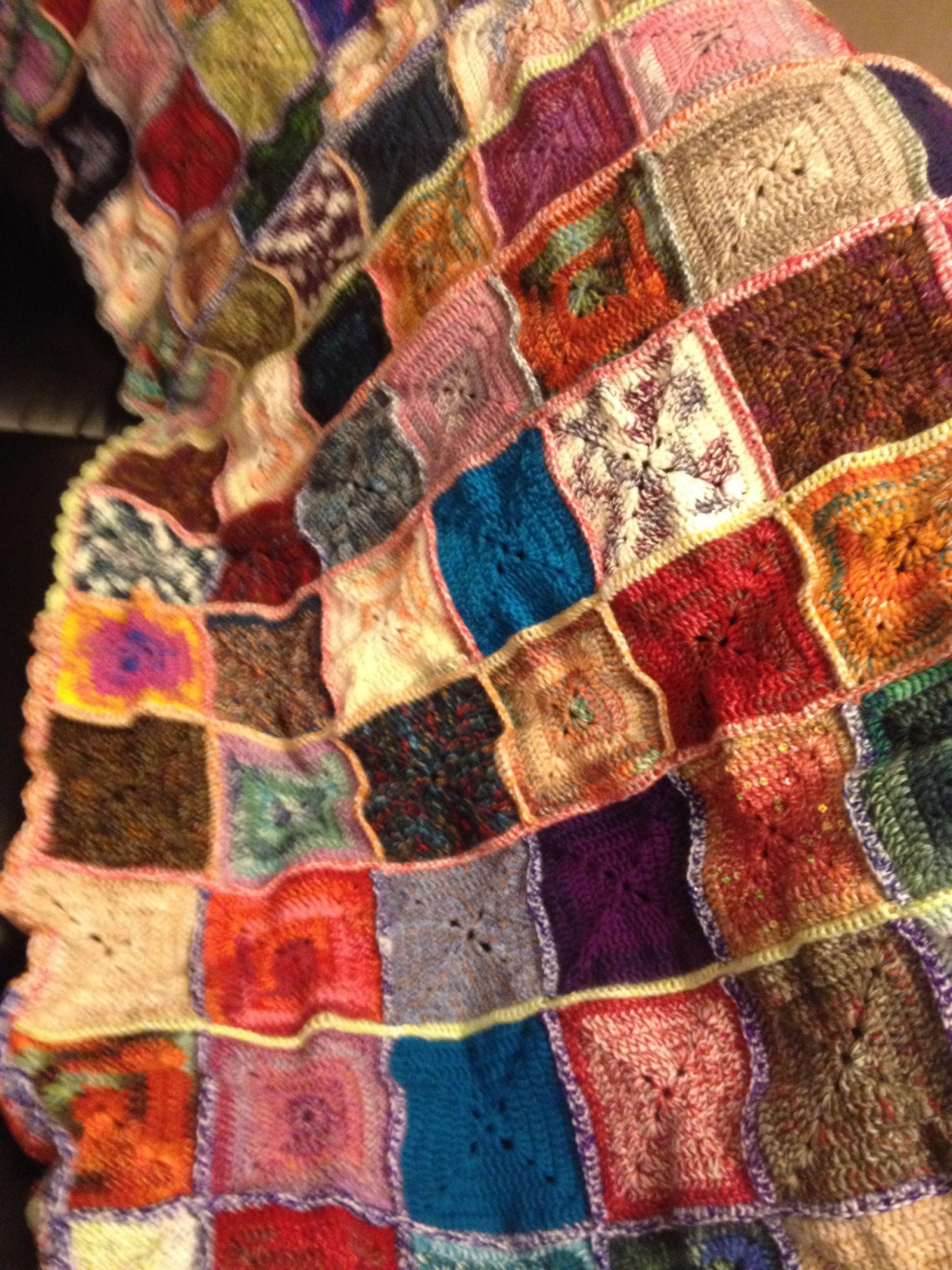 Crocheted blanket of many colors mane from left over sock yarn. By Jen denhertog