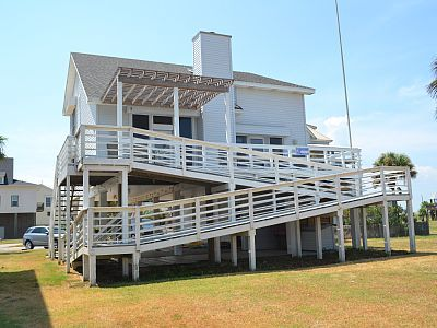 Back deck with stairs and ramp access. Partially shaded deck.