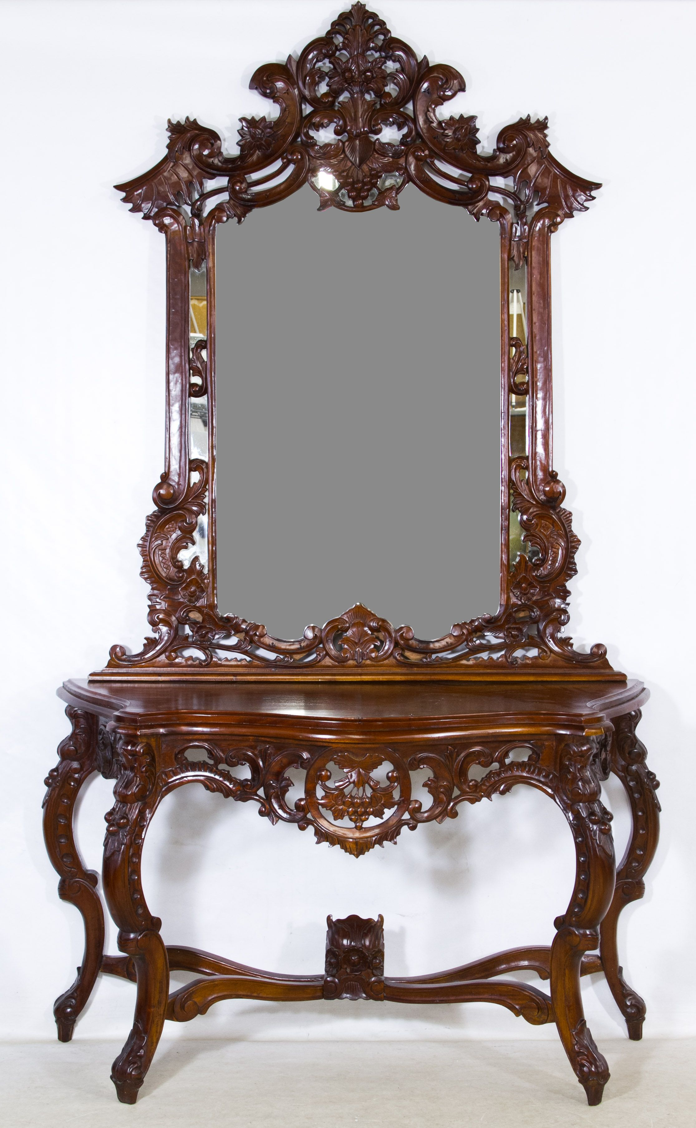 Lot Mahogany Foyer Table and Mirror; Indonesia, highly carved wood frame mirror  on table with carved serpentine legs